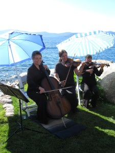 Sierra Strings Wedding Music in Tahoe Trio Under Umbrellas